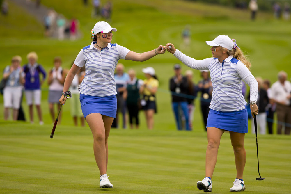 GB&I team members Olivia Mehaffey, (left), and Bronte Law celebrate after winning the par-4 14th hole with a birdie during morning foursomes at the 2016 Curtis Cup at Dun Laoghaire Golf Club near Dublin, Ireland on Friday, June 10, 2016. (Copyright USGA/Steven Gibbons)