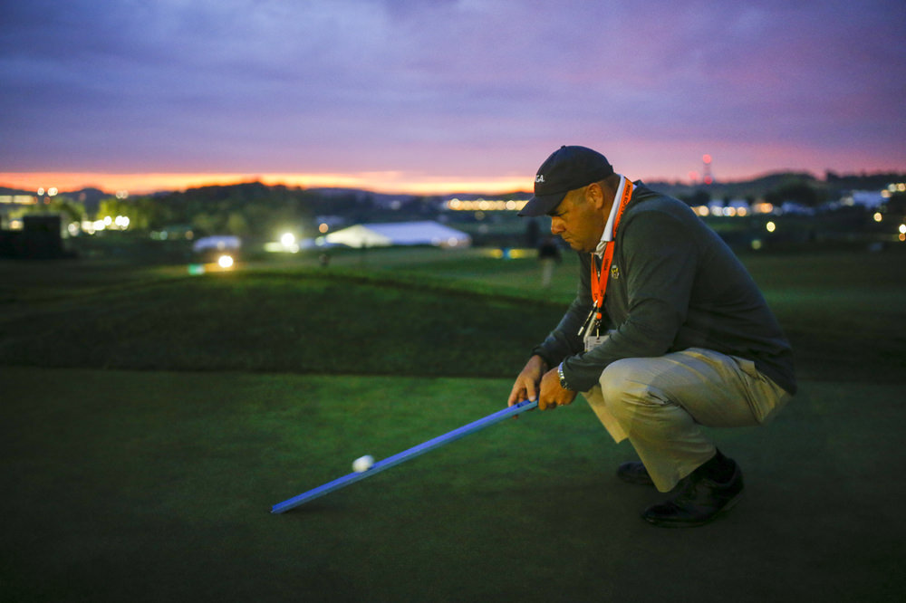 Darin Bevard using a stimpmeter on the ninth green during a practice round for the 2016 U.S. Open at Oakmont Country Club in Oakmont, Pa. on Wednesday, June 15, 2016. (Copyright USGA/Joel Kowsky)