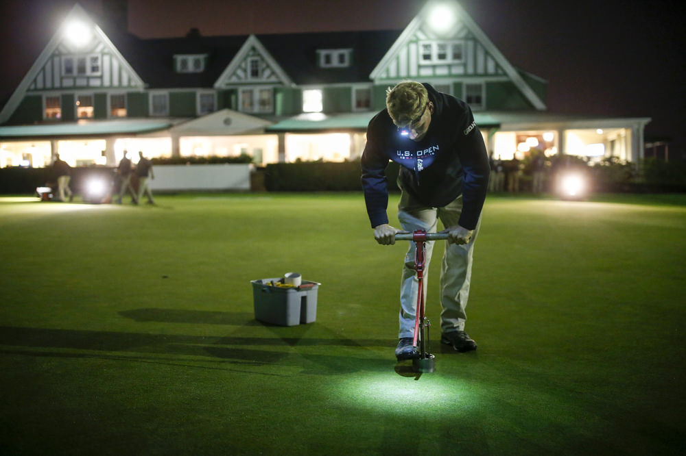 Member of the grounds crew cutting the hole on the practice green during a practice round for the 2016 U.S. Open at Oakmont Country Club in Oakmont, Pa. on Wednesday, June 15, 2016. (Copyright USGA/Joel Kowsky)
