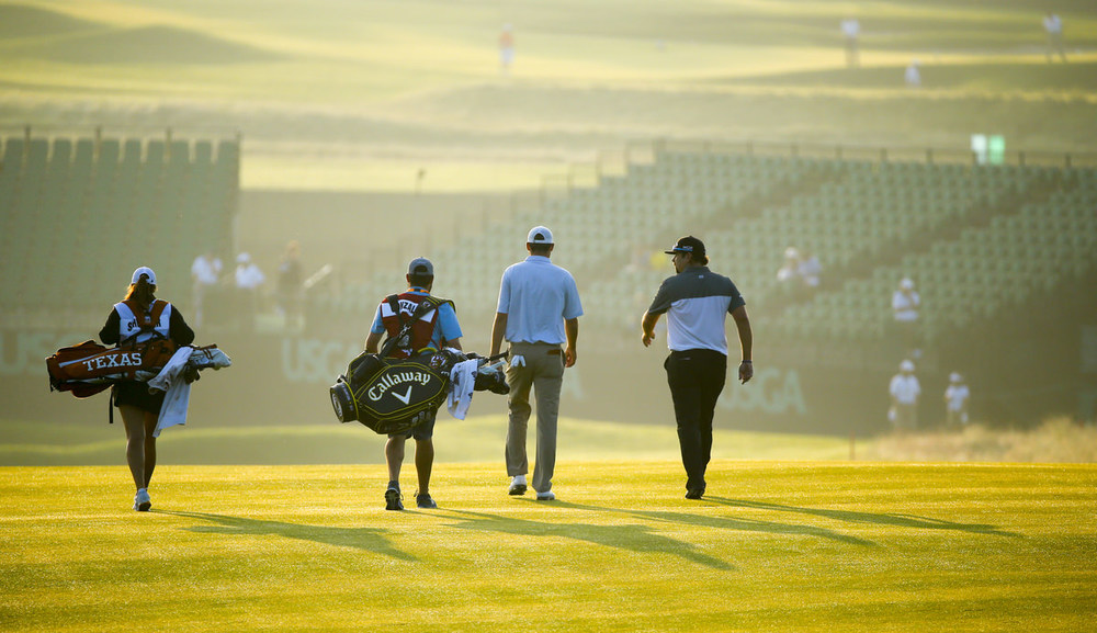 Andres Gonzales talks to Scottie Scheffler as they walk down the fairway on the 10th hole, their first,during the first round for the 2016 U.S. Open at Oakmont Country Club.(Copyright USGA/Jeff Haynes)