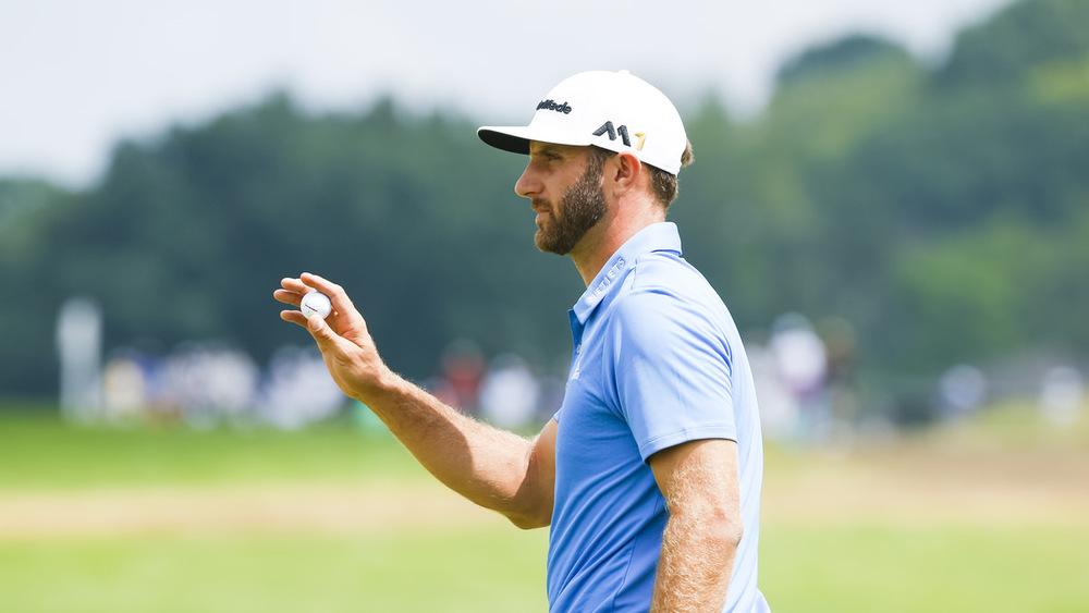 Dustin Johnson waves to the gallery after making a par on the eighth hole during the first round of the 2016 U.S. Open at Oakmont Country Club in Oakmont, Pa. on Friday, June 17, 2016. (Copyright USGA/Michael Cohen)