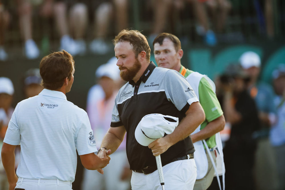 Shane Lowry shakes hands with Andrew Landry at the end of their round during the final round of the 2016 U.S. Open at Oakmont Country Club in Oakmont, Pa. on Sunday, June 19, 2016. (Copyright USGA/Joel Kowsky)