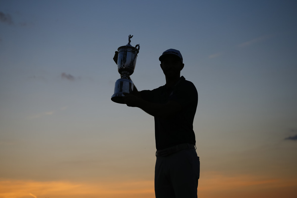 Dustin Johnson poses with the trophy after winning the 2016 U.S. Open at Oakmont Country Club in Oakmont, Pa. on Sunday, June 19, 2016. (Copyright USGA/JD Cuban
