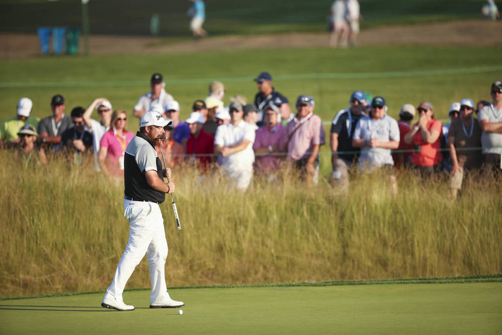 Shane Lowry bites his putter after missing a par putt on the 14th hole during the final round of the 2016 U.S. Open at Oakmont Country Club in Oakmont, Pa. on Sunday, June 19, 2016. (Copyright USGA/Darren Carroll)