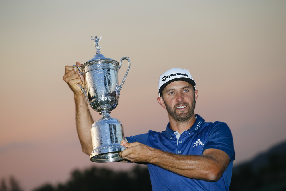 Dustin Johnson poses with the trophy after winning the 2016 U.S. Open at Oakmont Country Club in Oakmont, Pa. on Sunday, June 19, 2016. (Copyright USGA/Jeff Haynes)