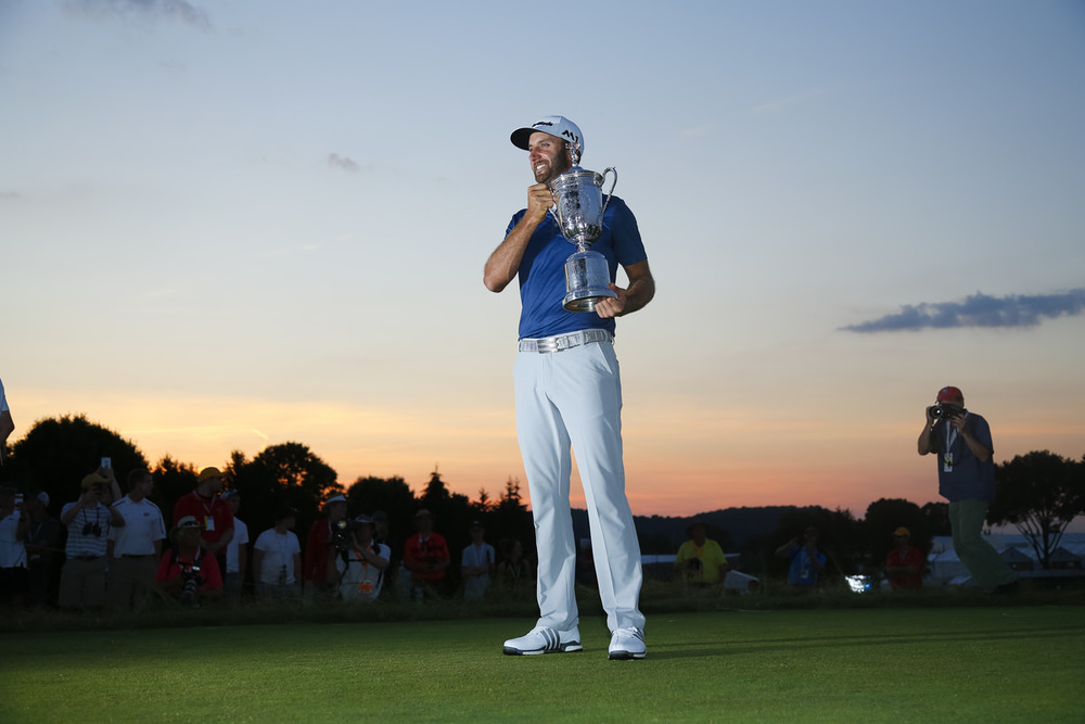 Dustin Johnson poses with the trophy after winning the 2016 U.S. Open at Oakmont Country Club in Oakmont, Pa. on Sunday, June 19, 2016. (Copyright USGA/JD Cuban)