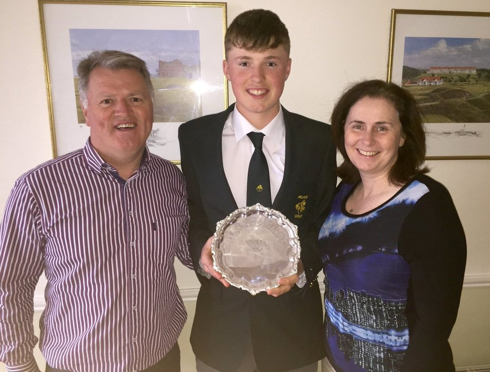 Mark Power shows off the Peter McEvoy Trophy with his parents Eddie and Eileen Rose, both three time former Irish Amateur Close champions. Picture, courtesy Eddie Power