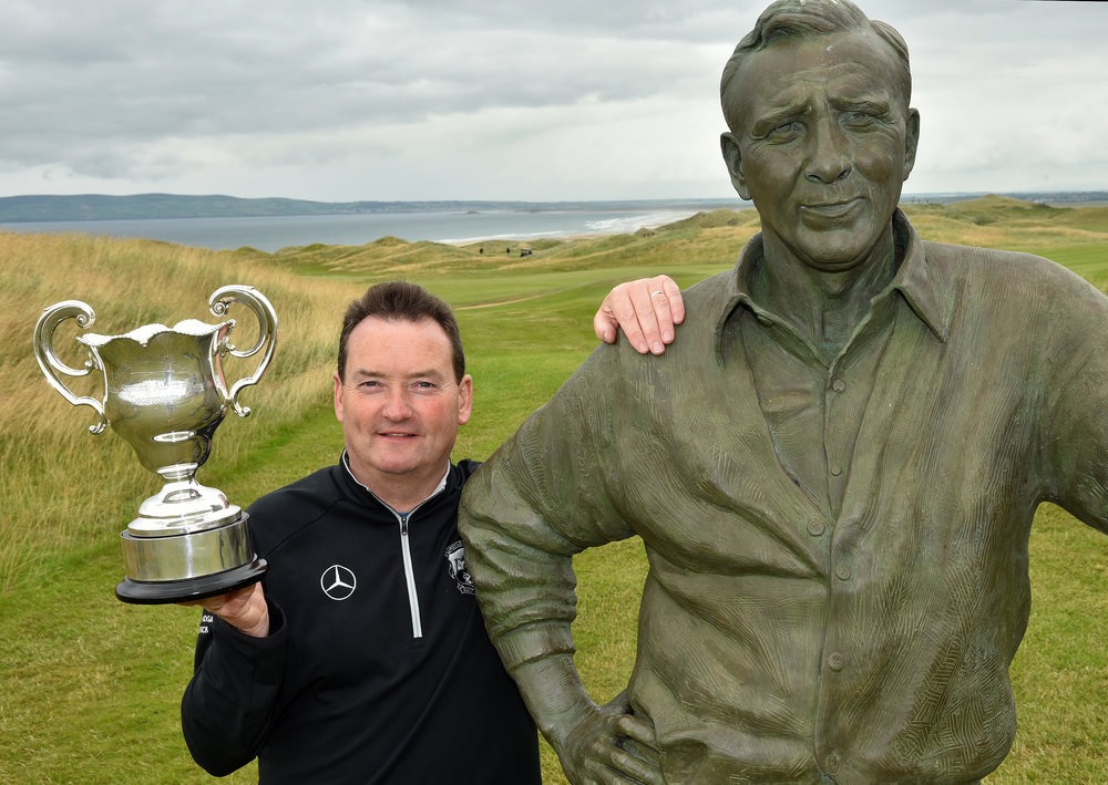 Winner Eamonn Haugh (Castletroy) with the Arnold Palmer statue after his victory in the Irish Seniors Amateur Close Championship at Tralee Golf Club. Picture by  Pat Cashman