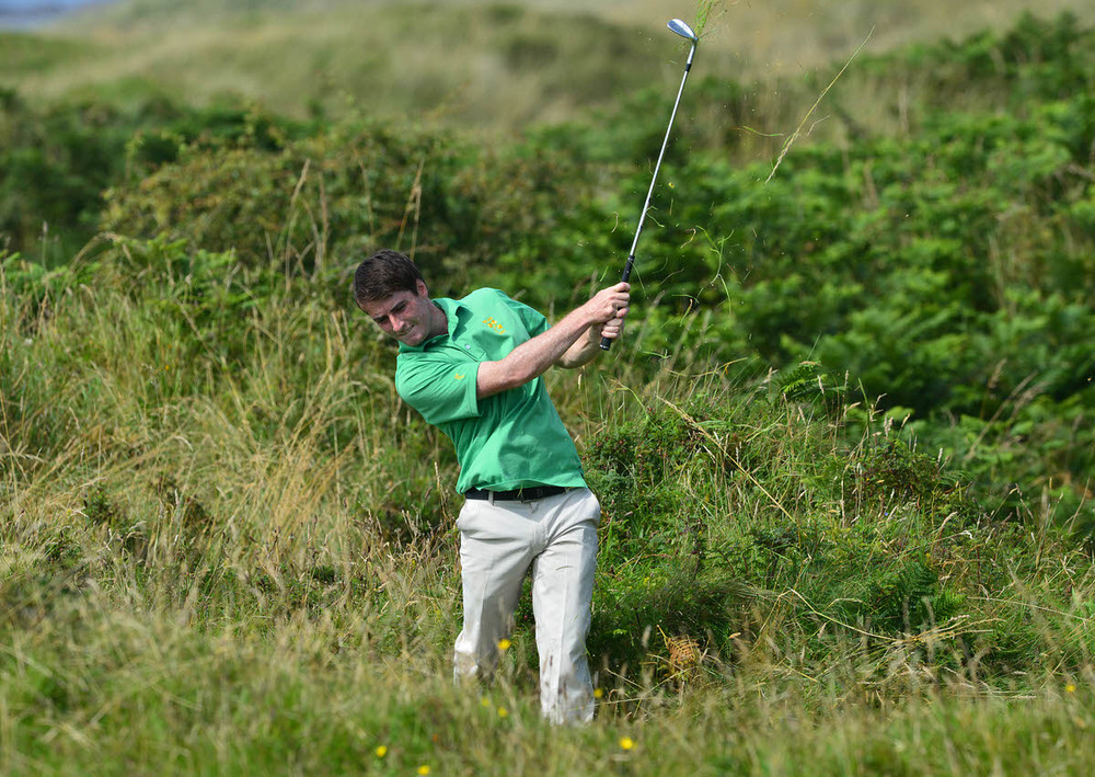 Dermot McElroy (Ireland) playing from the rough at the 9th hole during the second day of the 2015 Home International Matches at Royal Portrush Golf Club today (13/08/2015). Picture by Pat Cashman