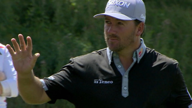 Graeme McDowell acknowledges fans after a late chip-in