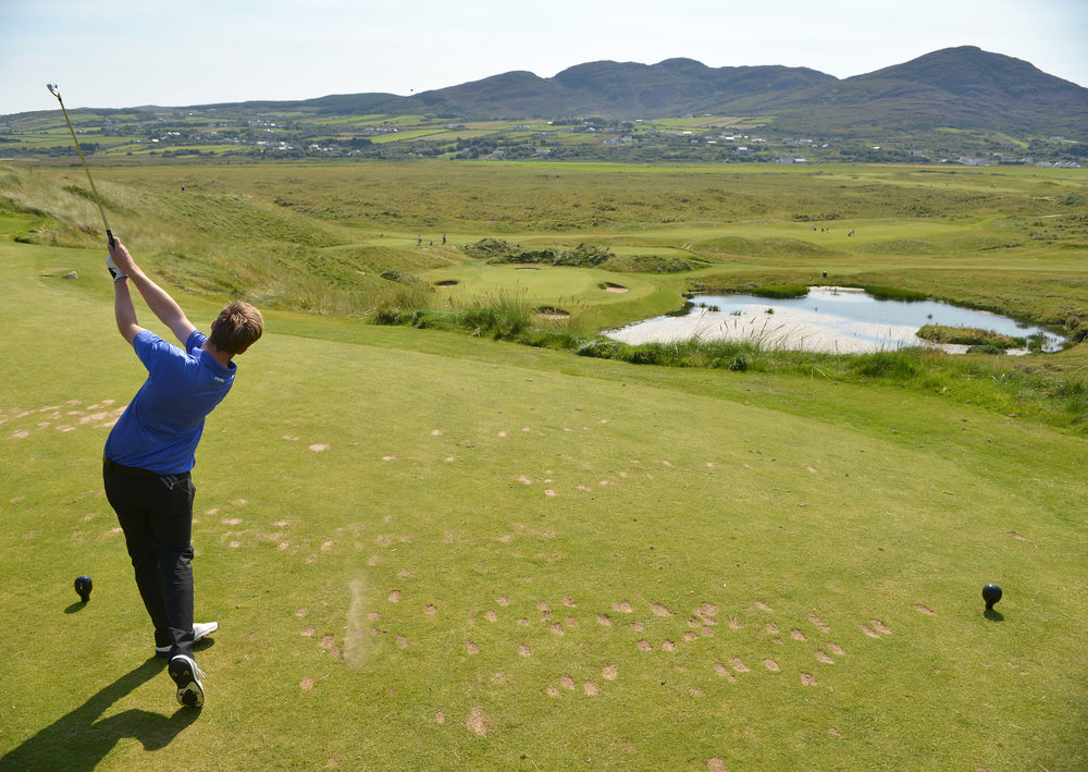 Thomas Mulligan (Co Louth) playing his six-iron to the seventh green during the first strokeplay round of the 2016 Irish Amateur Close Championship at Ballyliffin Golf Club today (16/08/2016). Picture by  Pat Cashman
