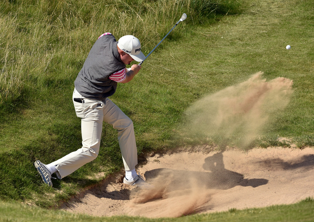 Robin Dawson (Tramore / Maynooth University) bunkered at the fifth green during the first strokeplay round of the 2016 Irish Amateur Close Championship at Ballyliffin Golf Club today (16/08/2016). Picture by  Pat Cashman