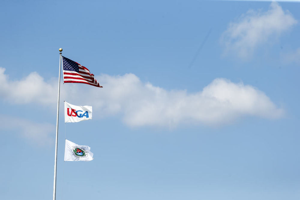 Flags blow in the wind during the first round of match play at the 2016 U.S. Amateur at Oakland Hills Country Club in Bloomfield Hills, Mich. on Wednesday, Aug. 17, 2016. (Copyright USGA/Chris Keane)