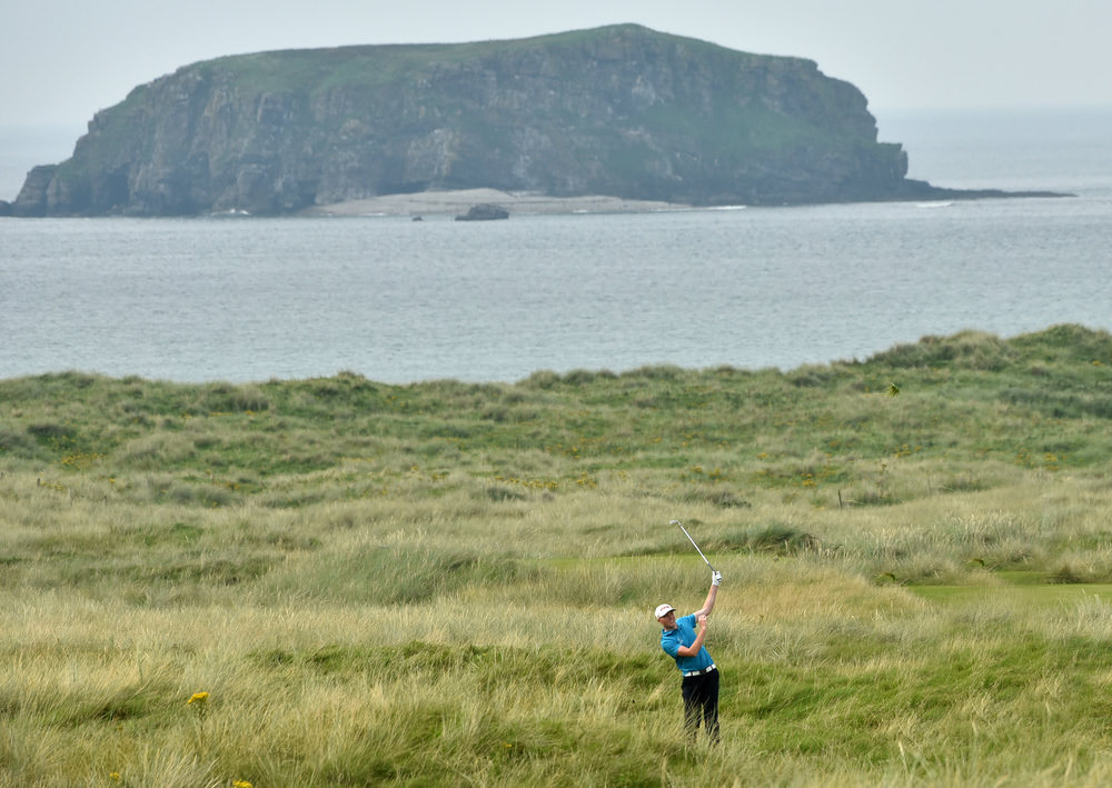 Robin Dawson (Tramore / Maynooth University) in rough at the 13th hole at the AIG Irish Amateur Close Championship at Ballyliffin Golf Club today (18/08/2016). Picture by Pat Cashman