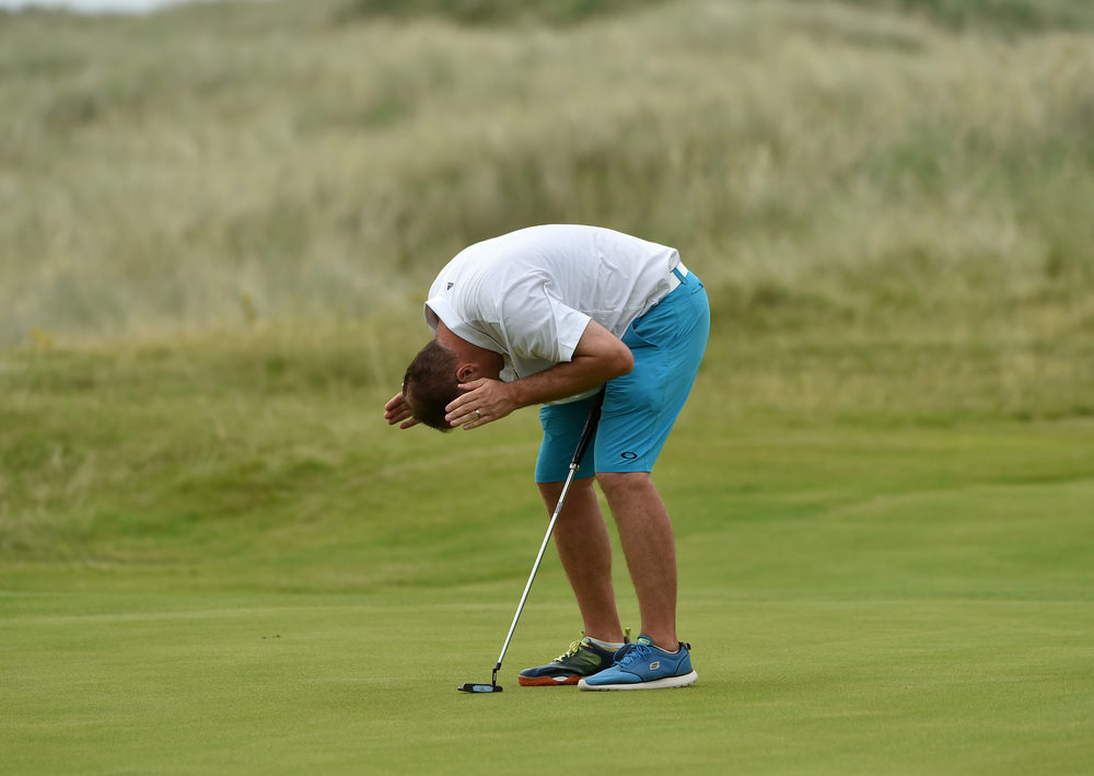 Ben Best (Rathmore) reacts to a missed putt on the 17th green at the AIG Irish Amateur Close Championship at Ballyliffin Golf Club today (18/08/2016). Picture by Pat Cashman