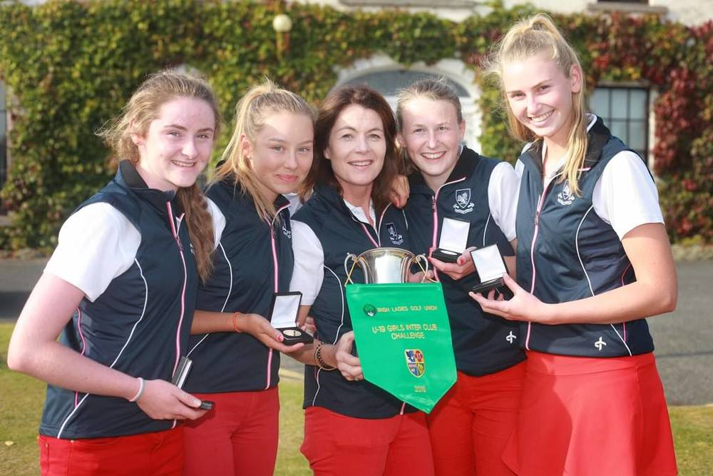Milltown celebrate their victory in the Girls Interclub All Ireland at Greystones: Ellen O'Gorman, Georgia Carr, Rhona Breslin (manager), Emma Walsh and Aisling Walsh. Picture: Ronan Lang