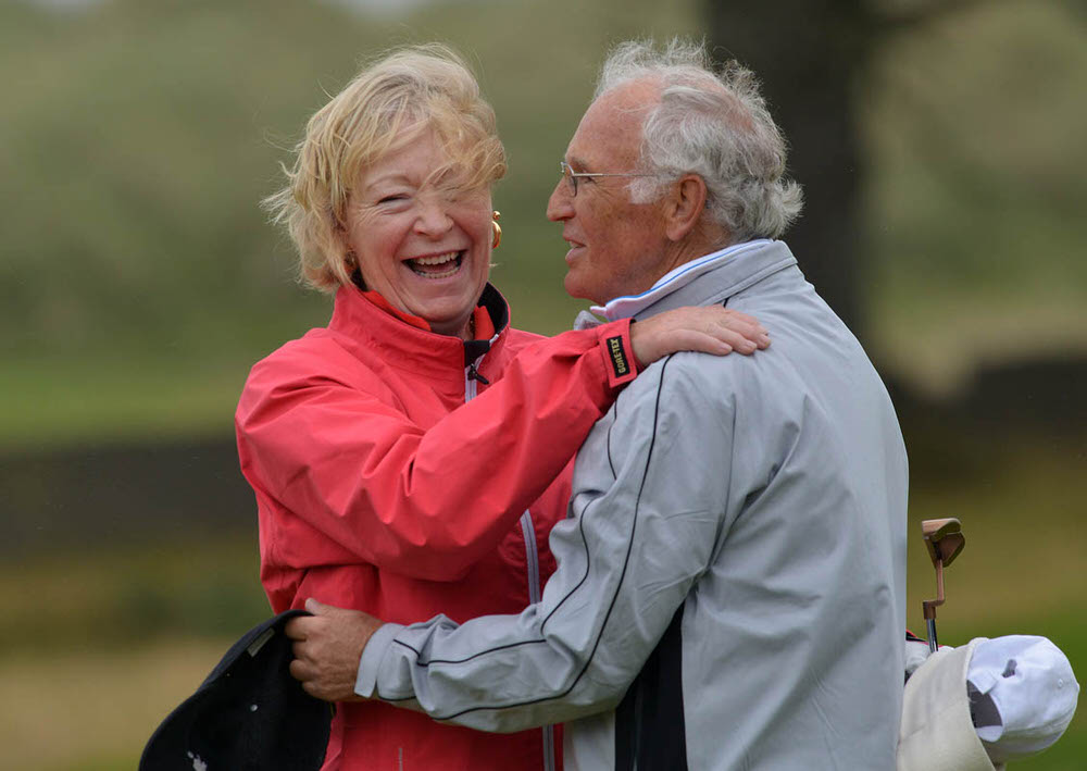 Winner Marilyn Henderson (Royal Belfast) is congratulated by her caddy, husband Gordon, after holing her final putt on the 18th green in the 2015 Irish Senior Women's Open Strokeplay. Picture by Pat Cashman