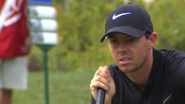 Rory McIlroy reading a putt