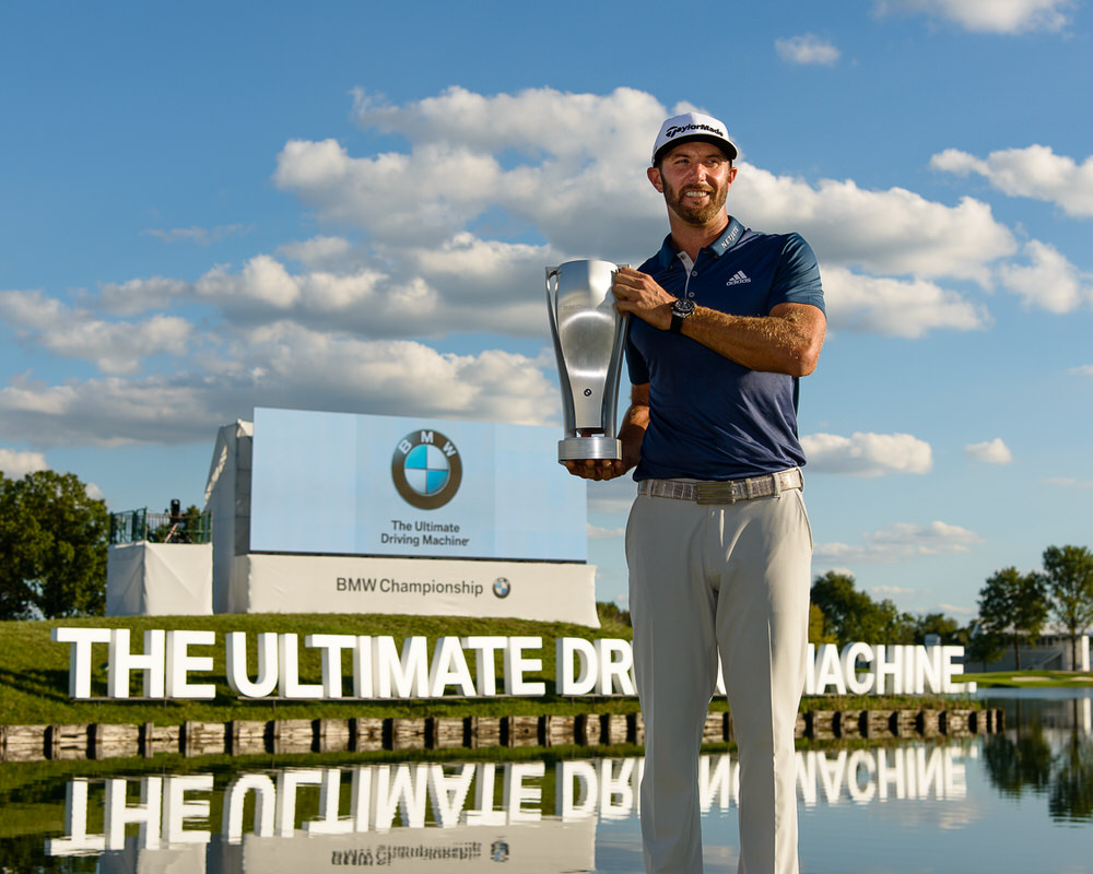 Dustin Johnson with the BMW Championship trophy