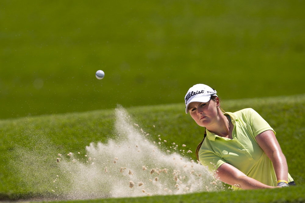 Olivia Mehaffey of Ireland plays her second shot from a greenside bunker at the eighth hole during the third round of the 2016 Espirito Santo Trophy at Iberostar Playa Paraiso Golf Club in Riviera Maya, Mexico on Friday, Sept. 16, 2016.  (Copyright USGA/Steven Gibbons)