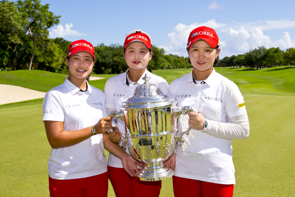 Team members Min ji Park , (left), Hye jin Choi and Hyun kyung Park of Republic of Korea, hoist the trophy at the 18th green following the fourth round of the 2016 Espirito Santo Trophy at El Camaleon G.C. in Riviera Maya, Mexico on Saturday, Sept. 17, 2016.  (Copyright USGA/Steven Gibbons)
