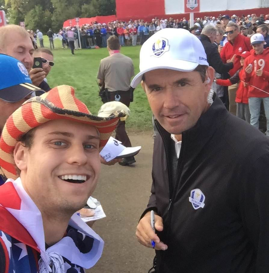 Pádraig Harrington poses with a US fan at Hazeltine