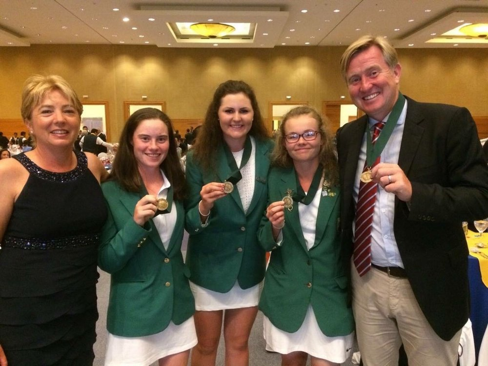 World bronze medalists Leona Maguire, Annabel Wilson and Olivia Mehaffey with the ILGU's David Kearney and Sandra Barnett.