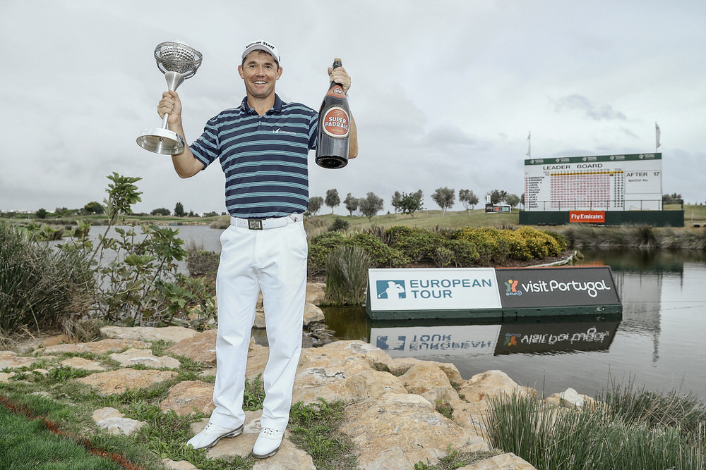 VILAMOURA, PORTUGAL - OCTOBER 23:  Padraig Harrington of Ireland poses with the trophy and a bottle of beer following his victory during day four of the Portugal Masters at Victoria Clube de Golfe on October 23, 2016 in Vilamoura, Portugal.  (Photo by Richard Heathcote/Getty Images)