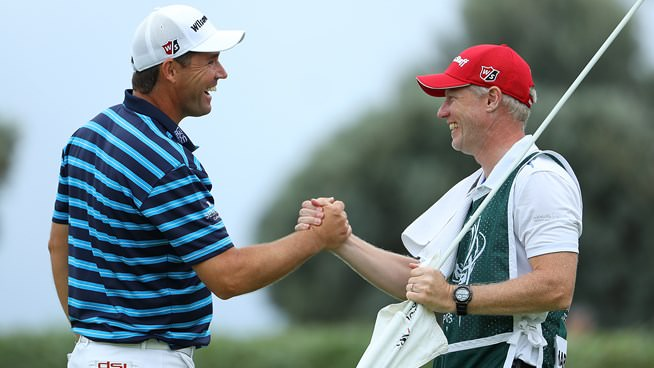 Pádraig Harrington and his caddie, Ronan Flood, celebrate his win in the 2016 Portugal Masters