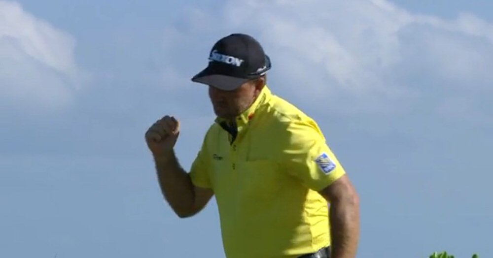 Graeme McDowell celebrates his birdie putt at the 15th