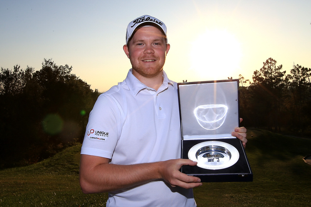 IRONA, SPAIN - NOVEMBER 17:  Tournament champion Nathan Kimsey of England poses following the final round of the European Tour qualifying school final stage at PGA Catalunya Resort on November 17, 2016 in Girona, Spain.  (Photo by Jan Kruger/Getty Images)