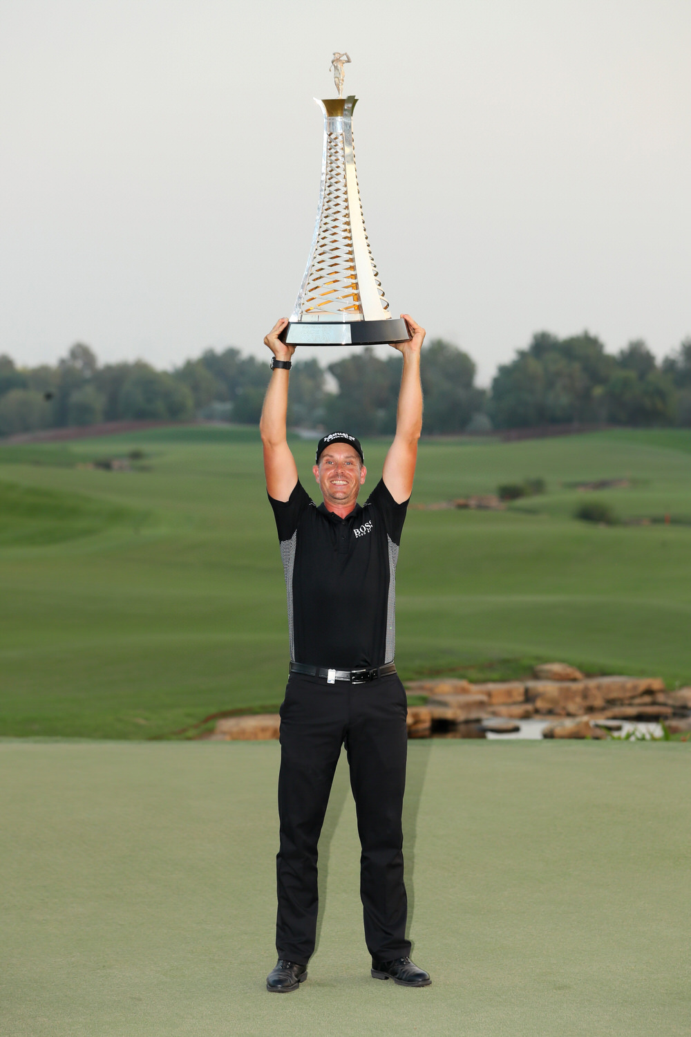 DUBAI, UNITED ARAB EMIRATES - NOVEMBER 20:  Henrik Stenson of Sweden poses with the Race to Dubai trophy during day four of the DP World Tour Championship at Jumeirah Golf Estates on November 20, 2016 in Dubai, United Arab Emirates.  (Photo by Andrew Redington/Getty Images)