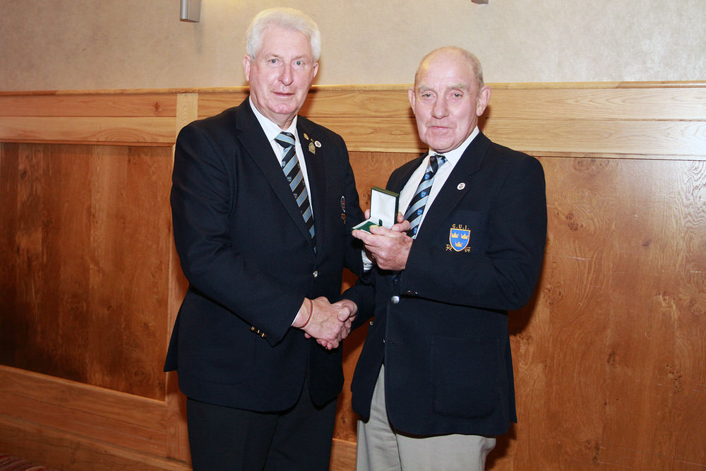 John Moloughney, Chairman Munster Golf presents John Fennessy with his medal after managing the victorious Munster Under 16 Interprovincial Championships. Picture: Niall O'She