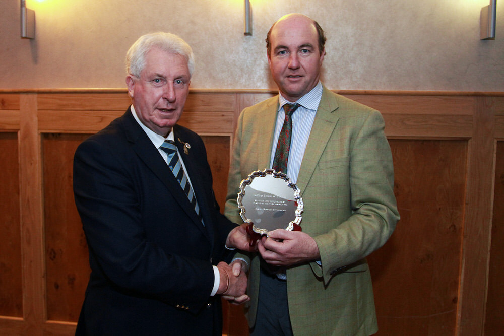 John Moloughney, Chairman Munster Golf presents John Dawson with the International Golfer of the Year, on behalf of his son Robin.Picture: Niall O'Shea