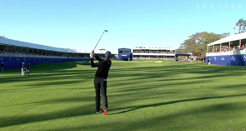 Justin Rose hits a knockdown shot to the 18th on the South Course
