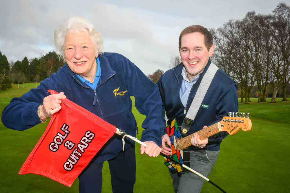 Dame Mary Peters and GolfNow's Andrew Hollywood are getting ready to rock and hole at the first ever 'Golf and Guitars' event which will take place at Holywood Golf Club on Friday May 19.