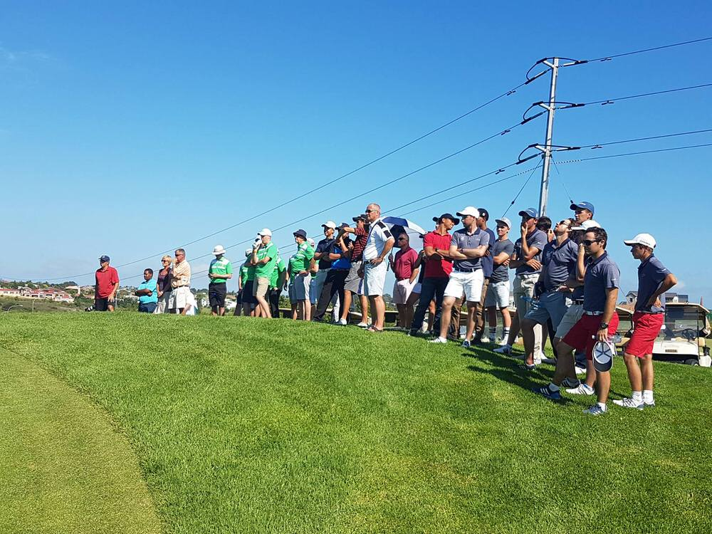Neil Manchi, Tony Goode and the rest of the Irish players watch Dawson in action over the final holes