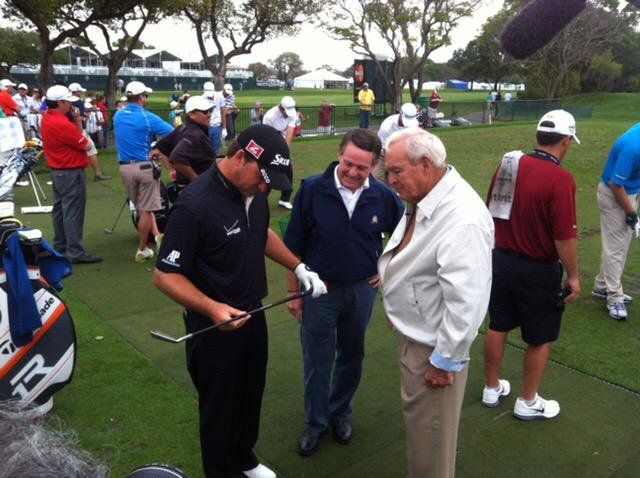 Graeme McDowell examines one of Arnold Palmer's old clubs at Bay Hill