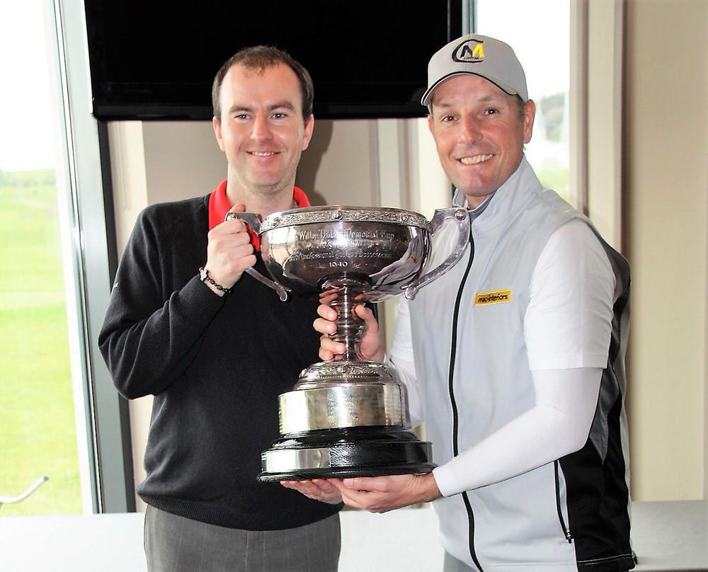 David Higgins (right) lifting the trophy last year from Sean O'Gallchoir, Director of Golf, Dunmurry Springs