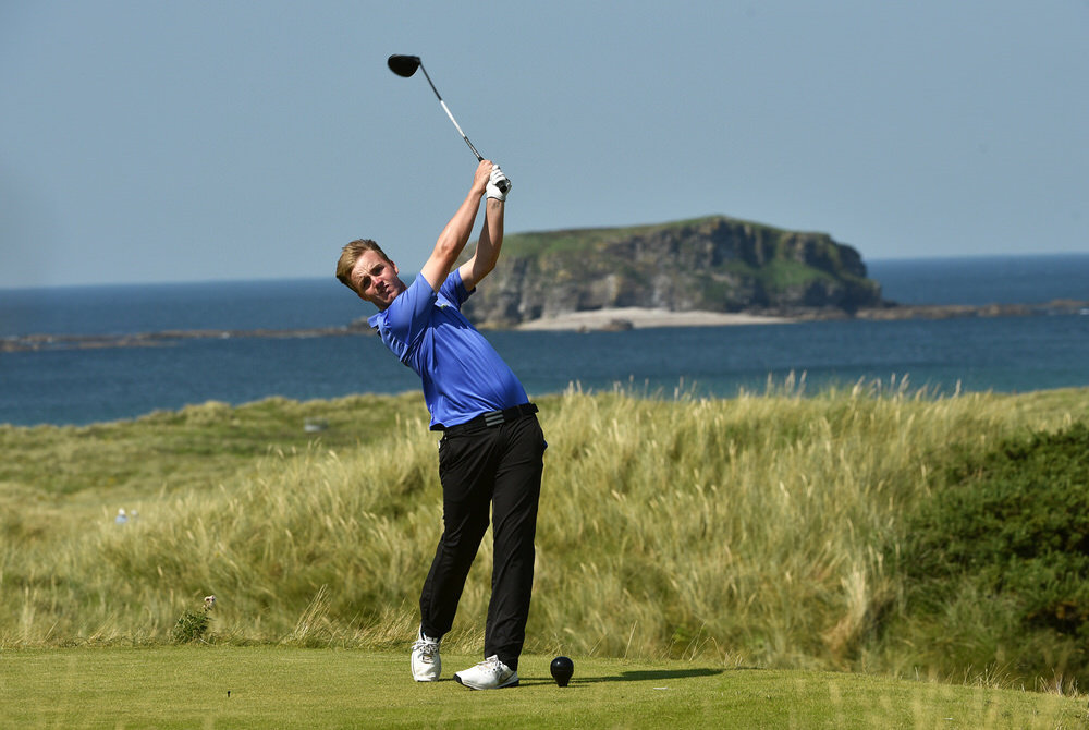 Thomas Mulligan (Co Louth) driving at the 6th tee with Glashedy Rock in the background during the first strokeplay round of the 2016 Irish Amateur Close Championship at Ballyliffin Golf Club (16/08/2016). Picture by  Pat Cashman