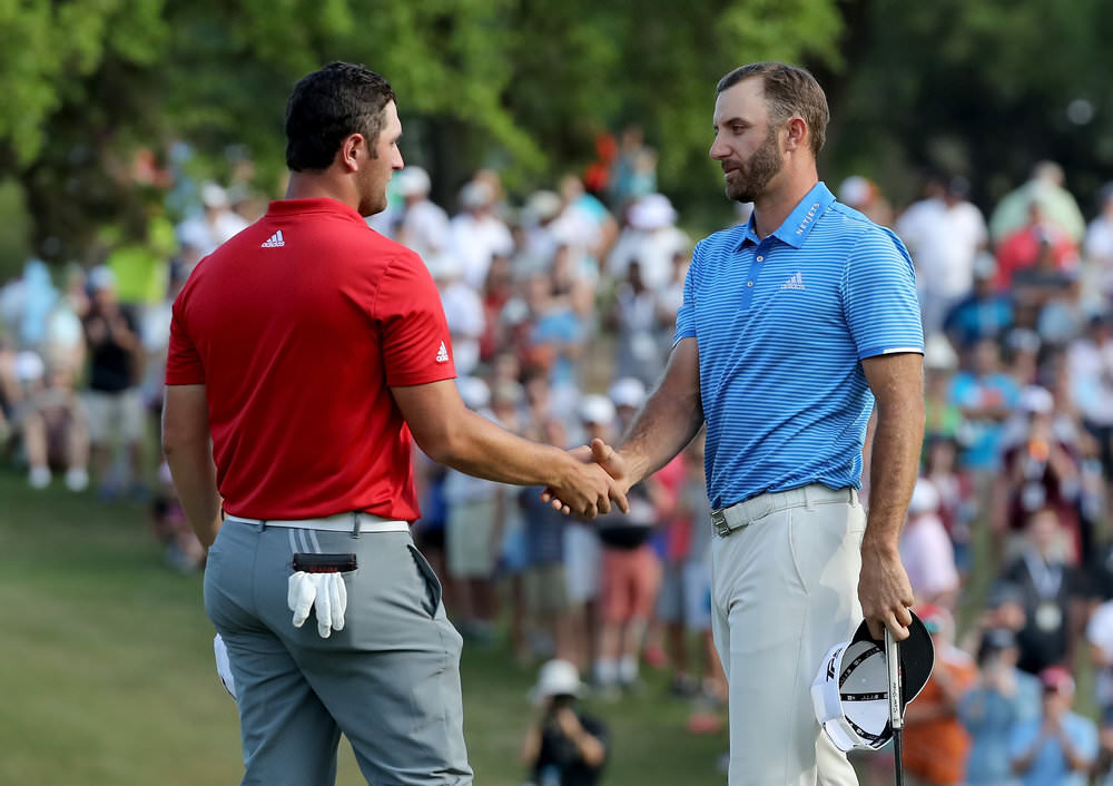 AUSTIN, TX - MARCH 26:  Dustin Johnson of the United States shakes hands with John Rahm of Spain (l) after his one-hole win during the final of the 2017 Dell Match Play. Photo by David Cannon/Getty Images