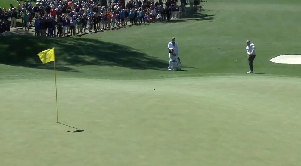 Rory McIlroy chips in at the 6th on Friday