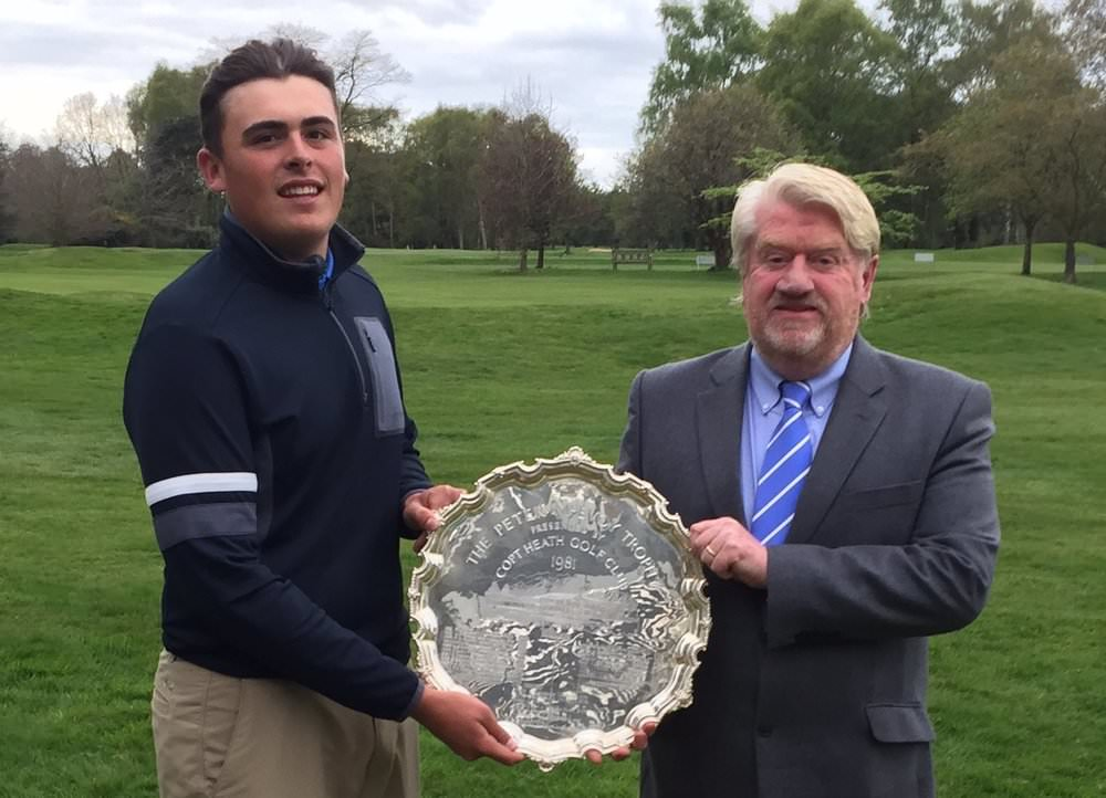 Charlie Strickland receives the McEvoy Trophy from Peter McEvoy