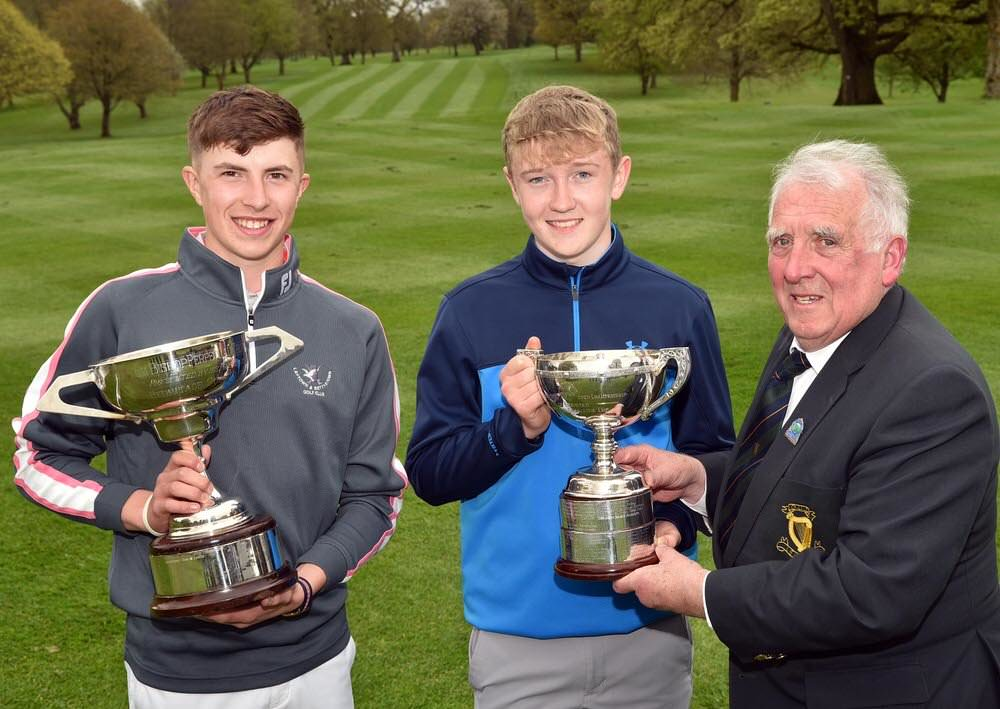 John Ferriter (Chairman, Leinster Golf, GUI) presenting winner Aaron Marshall (Lisburn) with the 2017 Leinster Boys Amateur Open Championship trophy Also in the picture is Alex Maguire, Laytown & Bettystown (Under 17 Winner). Picture by  Pat Cashman