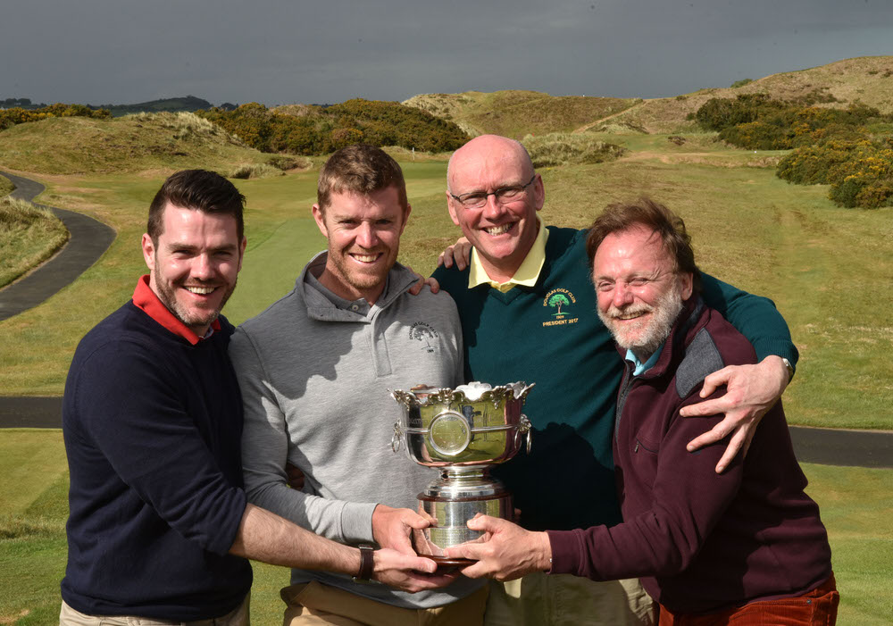 Peter O'Keeffe (Douglas) winner of the 2017 Flogas Irish Amateur Open Championship at Royal County Down Golf Club. Pictured with (from left) John (brother), John Boylan (President, Douglas Golf Club) and Noel (father). Picture by  Pat Cashman