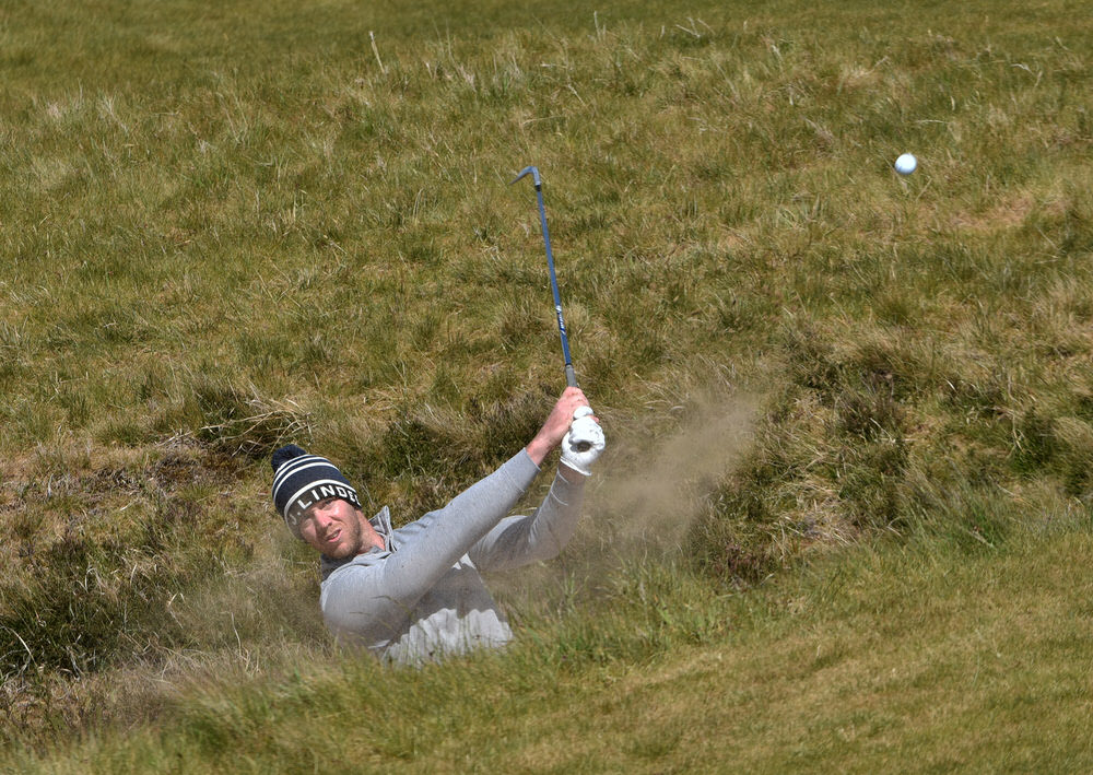 Peter O'Keeffe (Douglas) bunkered at the 16th during the final round of the Flogas Irish Amateur Open Championship at Royal County Down Golf Club (14/05/2017). Picture by  Pat Cashman