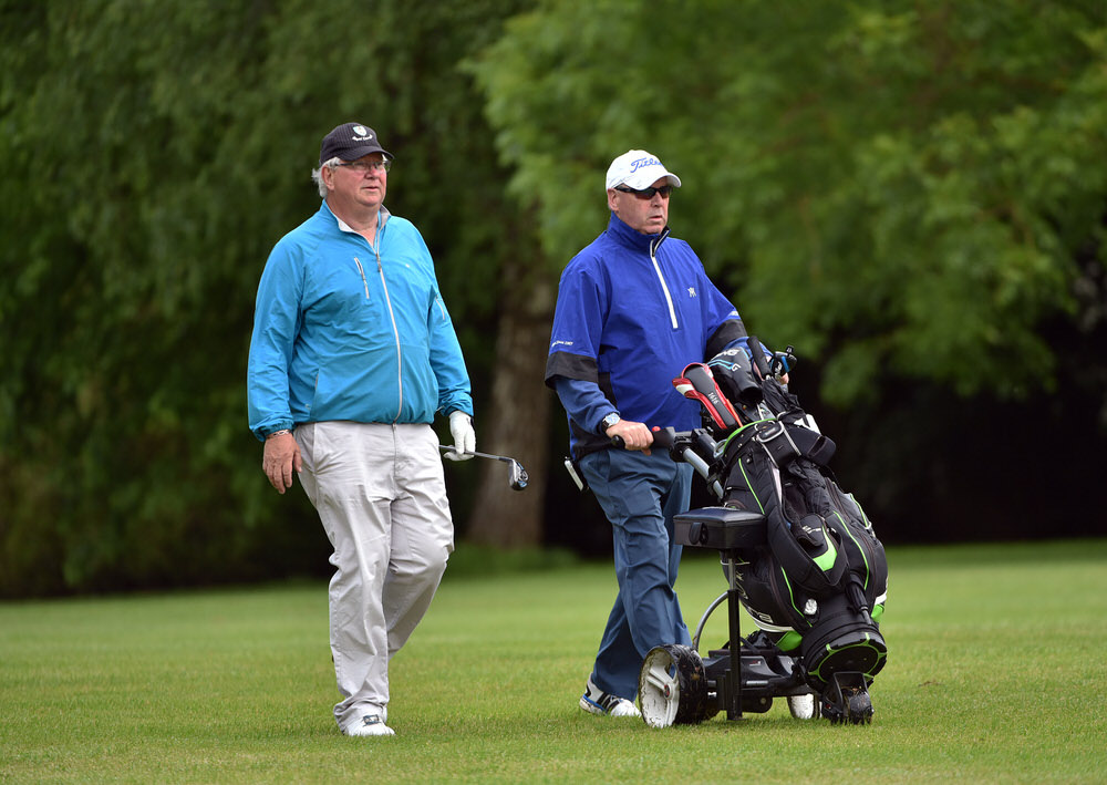 Master and apprentice. Ian Smyth usually caddies for his pal Garth McGimpsey if he misses the cut in a seniors event. This time it was the turn of 14-time championship winner Garth to repay the favour in the final round of the 2017 Irish Seniors Amateur Open at County Tipperary. Picture  Pat Cashman