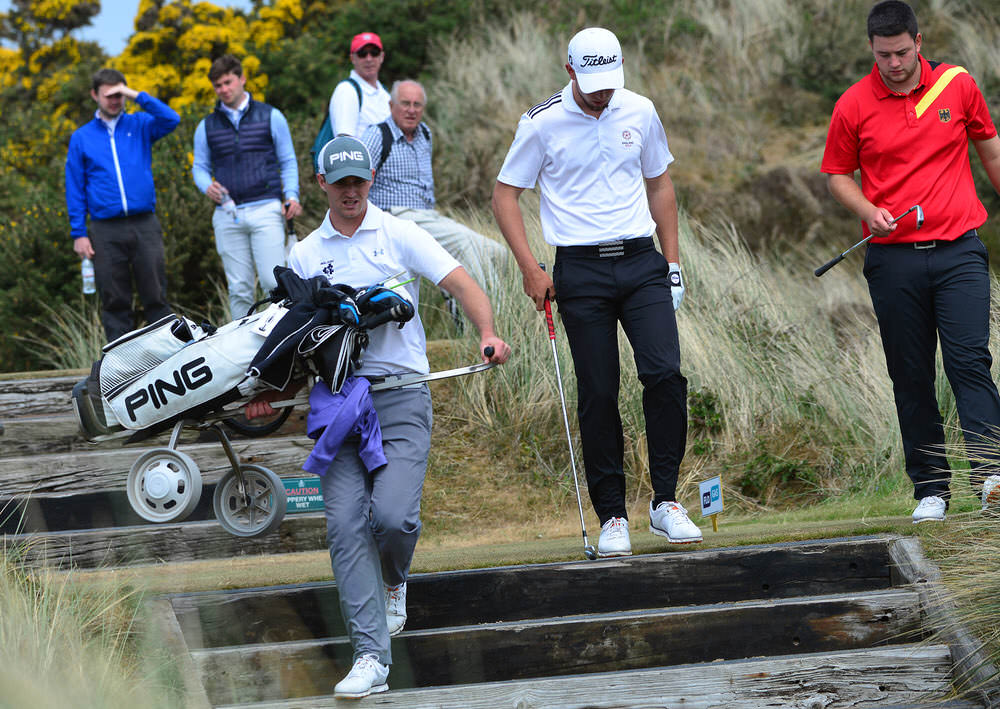 Conor O'Rourke carries his club down some steps at Royal County Down earlier this month. Picture: Pat Cashman