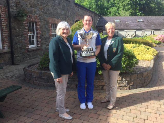 L-R: Ray Gregg (ILGU Ulster District Secretary), 2017 Ulster Women's champion Ciara Casey (Hermitage GC) and Joan Miller (ILGU Ulster District Chairman)