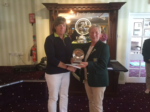 Dawn Scarborough (Temple Golf Club) is presented with the Ulster Women's Junior Championship.